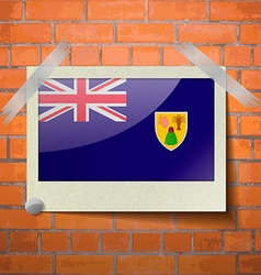 Flags turks and caicos scotch taped to a red brick vector