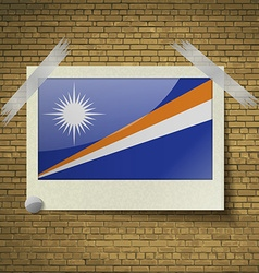Flags marshll islands at frame on a brick vector