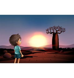 A boy at the desert watching the sunset vector