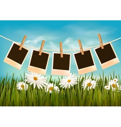 Photos hanging on a rope in front of a nature vector