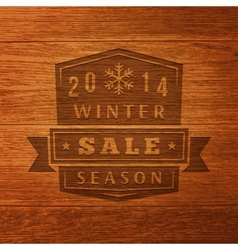 2014 winter sale label on wood texture background vector