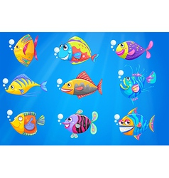 A group of beautiful fishes under the sea vector