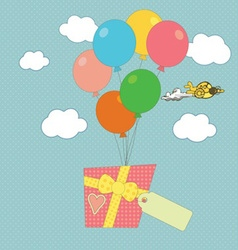 A gift carried by balloons vector