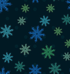Seamless pattern of snowflakes vector