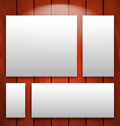 Gallery interior with empty frames on wooden wall vector