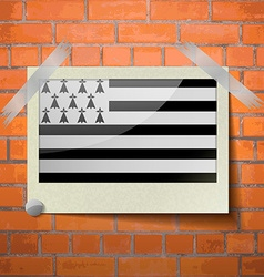 Flags brittany scotch taped to a red brick wall vector