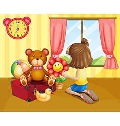 A child arranging her toys inside the house vector