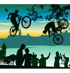 Two cyclists perform a jump over the crowd of vector