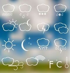 Weather icons on a blurred background vector