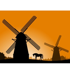 Windmills at sunset vector