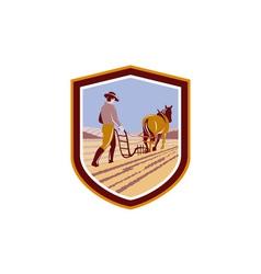 Farmer and horse plowing farm field crest retro vector