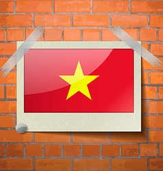 Flags vietnam scotch taped to a red brick wall vector