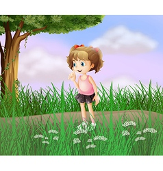 A cute little girl walking in the street vector