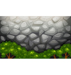 A high stonewall with trees vector