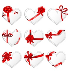 Festive heart-shaped cards with red gift ribbons vector
