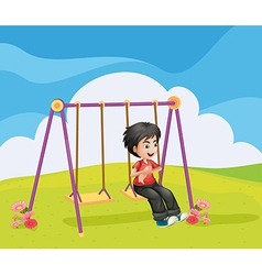 A boy swinging alone vector