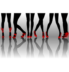 Female legs silhouettes with red shoes vector
