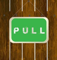 Pull sign hanging on a wooden fence vector
