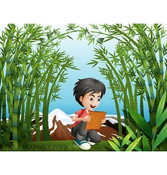 A boy holding a frame at the rainforest vector