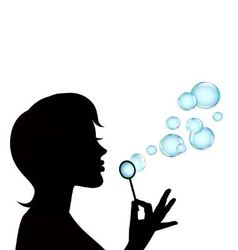 Female silhouette and soap bubbles vector