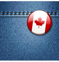 Canadian flag badge on denim fabric texture vector