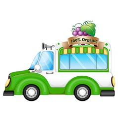 A green vehicle selling organic fruits vector