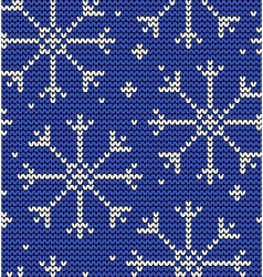 Knitted seamless winter pattern with snowflakes vector
