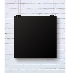 Black blank piece of paper on the white brick wall vector