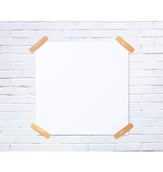 White square blank piece of paper taped to the vector