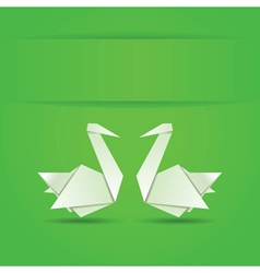Origami swans on green background vector
