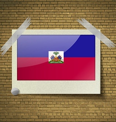 Flags haiti at frame on a brick background vector