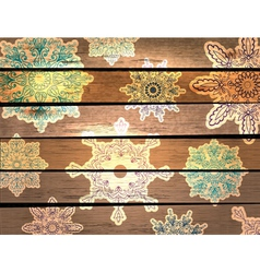 Wood background with beautiful snowflakes vector