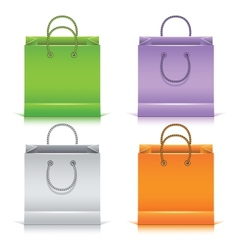 Set of the colorful paper shopping bags vector