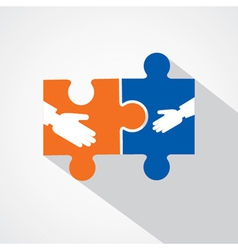 Businessman handshake with puzzle pieces vector