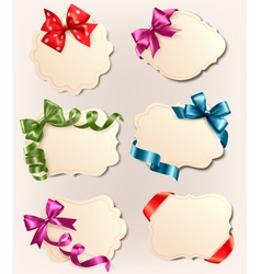 Set of retro labels with red gift bows and ribbons vector