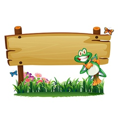 An empty wooden signboard with a playful frog vector
