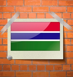 Flags gambia scotch taped to a red brick wall vector