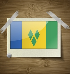 Flags saint vincent grenadines at frame on wooden vector