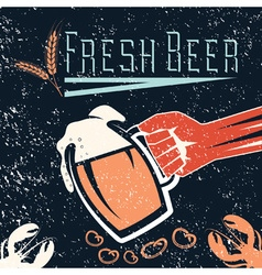 Hand with a glass of beer on grunge background vector