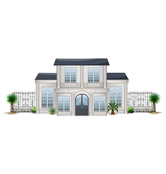 A big house with palm plants vector