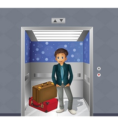 A boy with two travelling bags inside the elevator vector