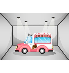 A pink ice cream car inside the garage vector