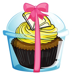 A cupcake with a yellow icing vector