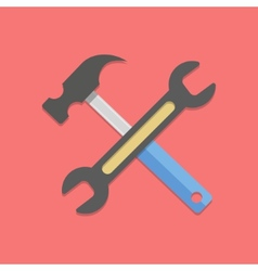Wrench and hammer on red background vector