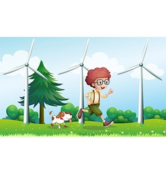 A boy running with a dog near the three windmills vector