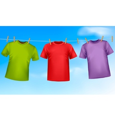 Set of colored t-shirts hanging on a clothesline vector