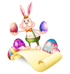 A rabbit holding two easter eggs vector