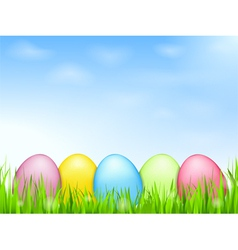 Colored eggs in grass vector