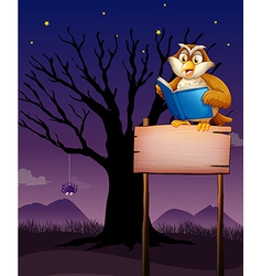 An owl reading above the empty signboard vector