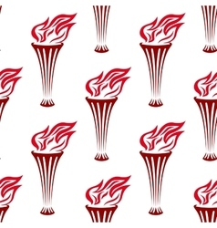 Seamless pattern of a red flaming torches vector